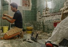 Photo of a young man renovating bathroom by himself